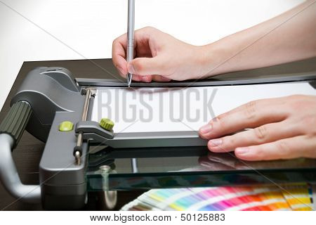 Man Working On The Guillotine For Paper