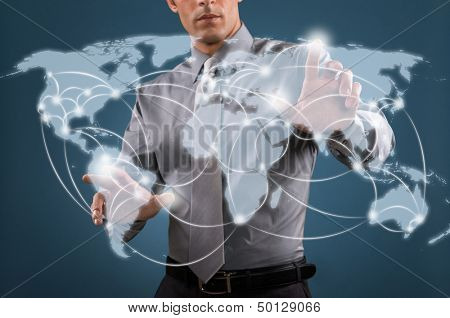 Businessman working on a digital map of the world, worldwide communication and network concept.