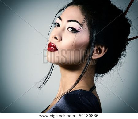 Young beautiful asian woman's portrait, studio shot toned