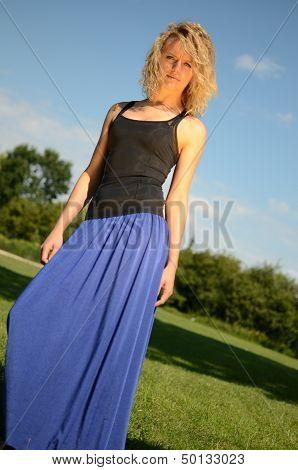 Blond Female Model In Blue Dress