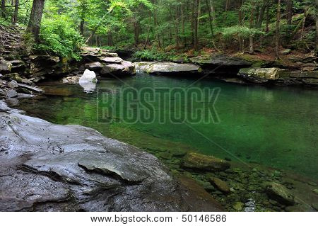 Mountain river with blue green water at Catskils mountains upstate NY
