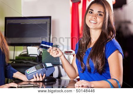 Cute girl at a cash register