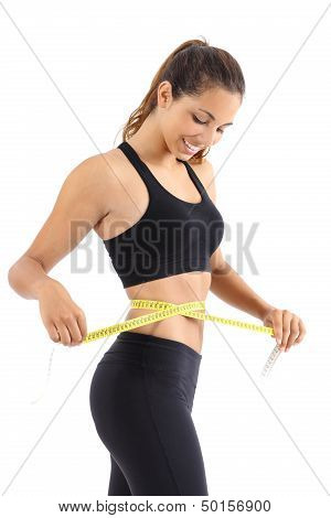 Sportswoman Measuring Her Waist With A Measure Tape