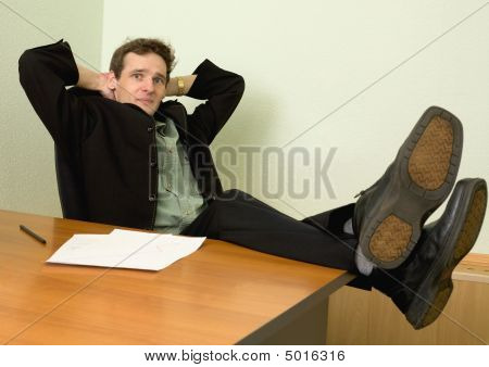 Boss In Black Suit On A Workplace