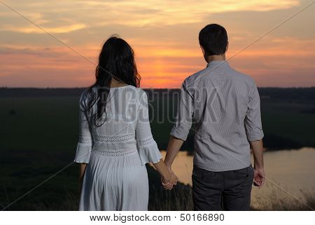Couple looking at sunset