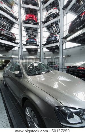 MOSCOW - JAN 11: Volkswagen Passat in the center of the multi-story automated car parking system in the tower to store cars in Volkswagen Center Varshavka on January 11, Moscow, Russia