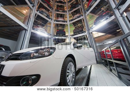 MOSCOW - JAN 11: The car with open door against the background of the other cars in tower for store cars in Volkswagen Center Varshavka at night on January 11, 2013, Moscow, Russia
