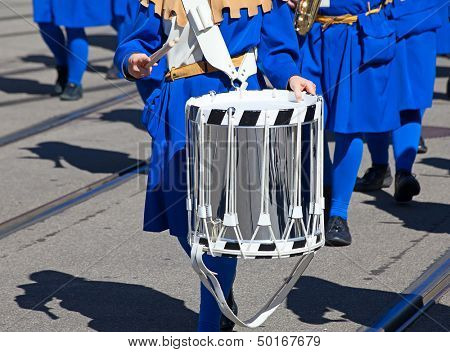 Drum in the hands of the musician on the street parade