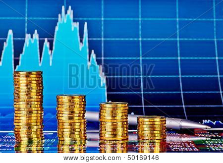 Downtrend Financial Chart, Pen And Stacks Of Golden Coins. Selective Focus