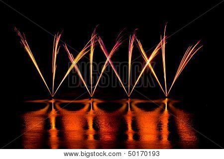 Streaks of Pink and Yellow Fireworks