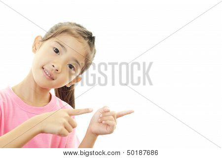 Happy Asian girl pointing.