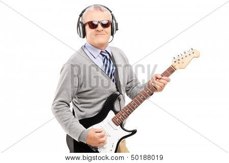 Mature man with glasses playing guitar isolated on white background
