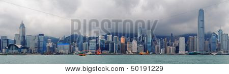 Urban architecture in Hong Kong Victoria Harbor with city skyline and cloud in the day.