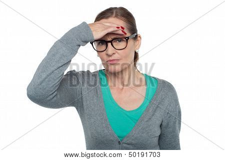 Expressionless Woman Looking At Distance Object