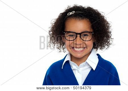 Bespectacled Primary Girl On A White Background