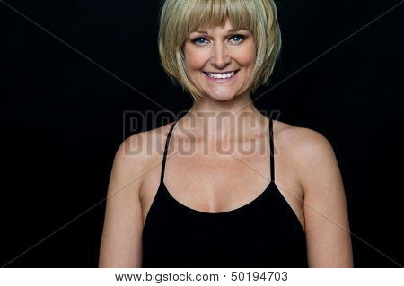 Glamorous Woman In Sleeveless Black Spaghetti Top