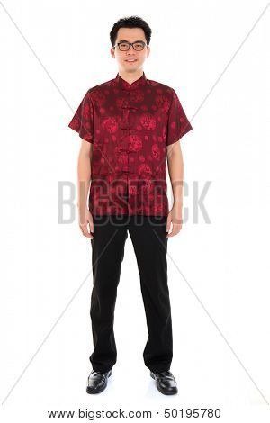 Full body portrait Asian man with Chinese traditional cheongsam or tang suit. Chinese New Year concept. Male model isolated on white background.