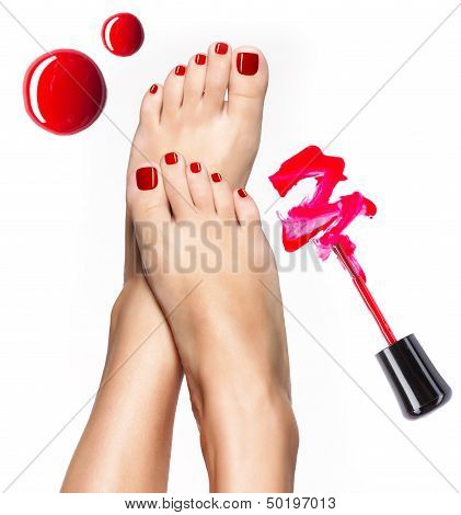 Beautiful Female Legs With Red Pedicure And  Nail Polish