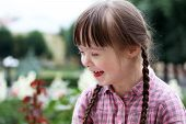 pic of playgroup  - Portrait of beautiful young girl smiling in the city - JPG
