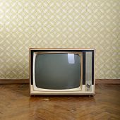 foto of analogy  - retro tv with wooden case in room with vintage wallper and parquet - JPG