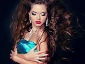 picture of blow-up  - Beautiful woman with long brown blowing hair - JPG