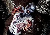 foto of gruesome  - young man with a zombie body painting - JPG