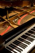 stock photo of grand piano  - Grand Concert Piano with the cover open angled view - JPG