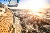 stock photo of sails  - Sailing to the Sunrise - JPG
