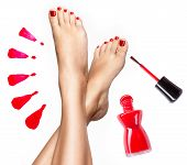 stock photo of toe nail  - Beautiful female legs with red pedicure and nail polish bottle with brush - JPG