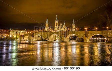 Ebro River And Stone Bridge In Zaragoza