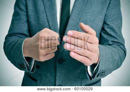man wearing a suit man in suit with a threatening gesture