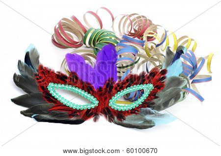 a carnival mask with feathers and paper streamers of different colors on a white background