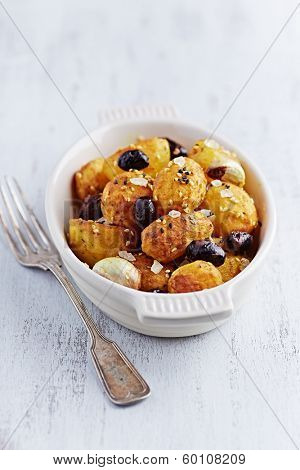 Oven-Baked Potatoes with Kalamata Olives, Turmeric and Sesame Seeds