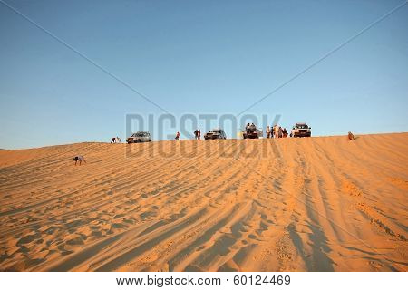 Tourists In Sahara