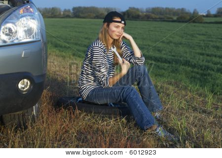 Girl And Broken Car