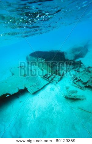Underwater photo of a sunken drug plane at Exuma, Bahamas