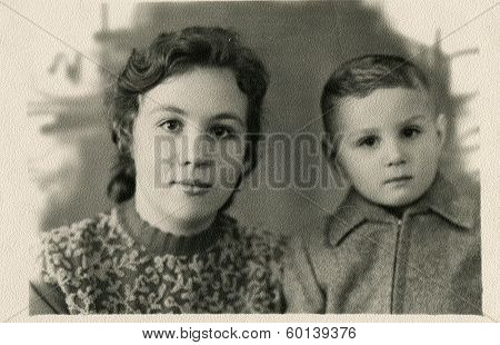 KURSK, USSR - CIRCA 1960s: An antique photo shows studio portrait of a young mother and her little son.