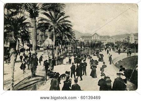 NICE, FRANCE - CIRCA 1909: An antique photo shows walking street near casino