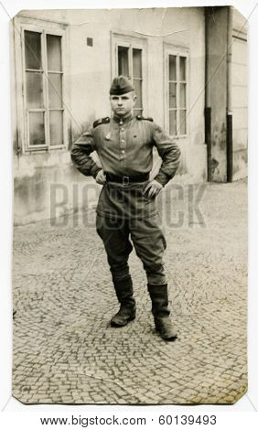 AUSTRIA - CIRCA 1945: An antique photo shows studio portrait of a Red Army officer, tank mechanic.
