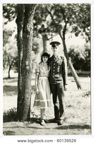 BASHKRIYA, USSR - CIRCA 1987: An antique photo shows portrait of a Soviet army soldier and his bride
