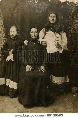 MOSCOW, RUSSIA - CIRCA 1900s: An antique photo shows studio portrait of three peasant women