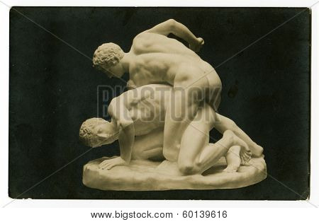 MOSCOW, RUSSIA - CIRCA 1900s: An antique photo shows an ancient statue athletes wrestlers
