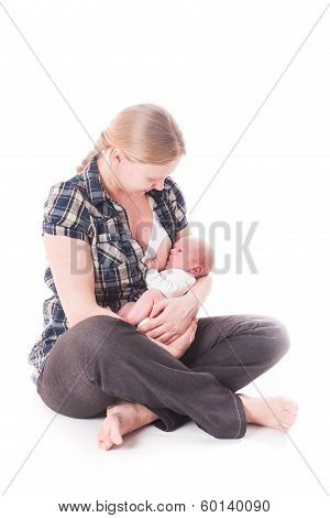 Mother breastfeeds her baby
