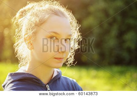Teenage Girl Restrained Smile In Front Of Camera