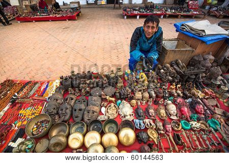 KATHMANDU, NEPAL - NOV 29, 2013: Unidentified sellers souvenirs at Durbar Square. Preference for construction of royal palaces at Durbar Square dates back to the 3 century.