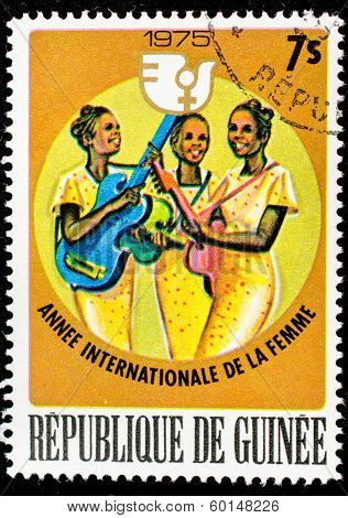GUINEA - CIRCA 1975: A stamp printed in Guinea shows an african women playing saxophone, circa 1975.