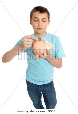 Child Placing Coins Into A Piggy Bank