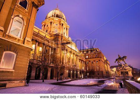 Snowy Buda Castle In Budapest Under A Purplish Blue Sky
