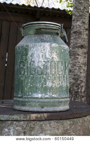 Large old metal milk can