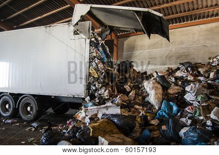 Recycle plant. truck unloading huge amounts of garbage, recycle plant in spain